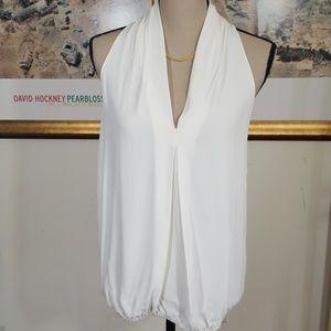 Studio M Ivory Sleevesles V deep neck. Size SX